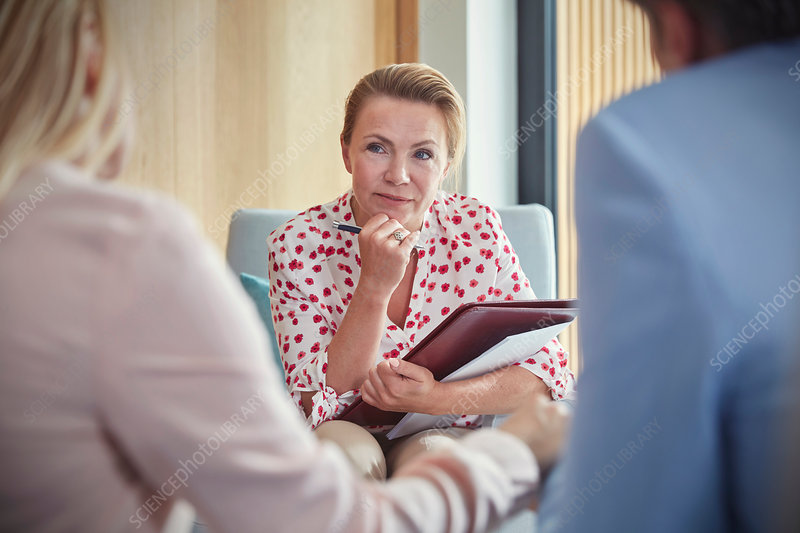 Therapist listening to couple in counselling