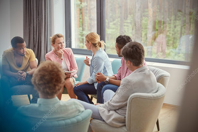 Women talking in group therapy session