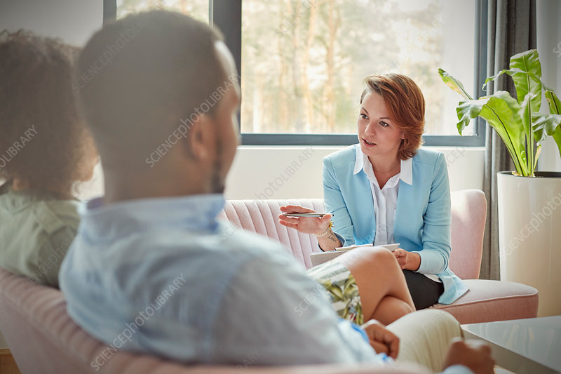 Therapist talking to couple in couples therapy