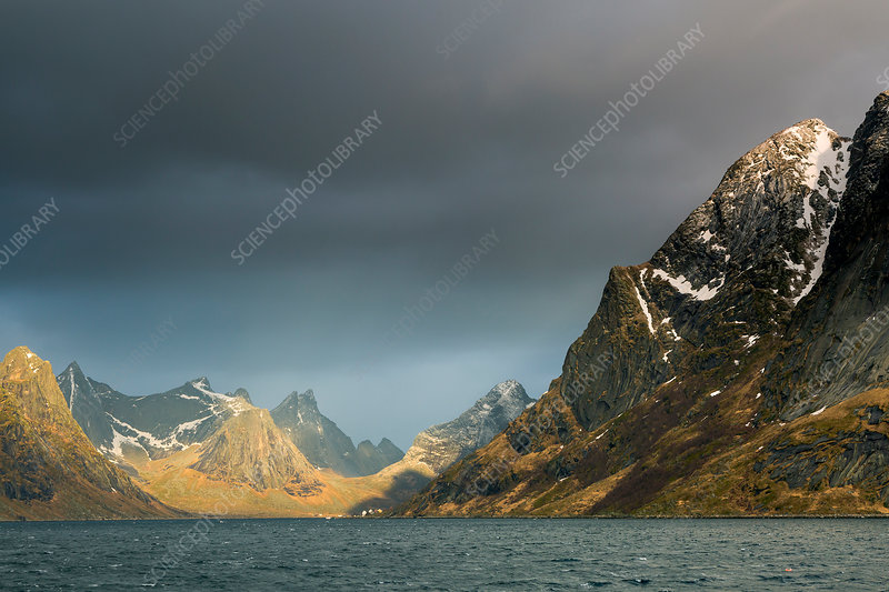 Dark clouds above rugged mountains, Norway