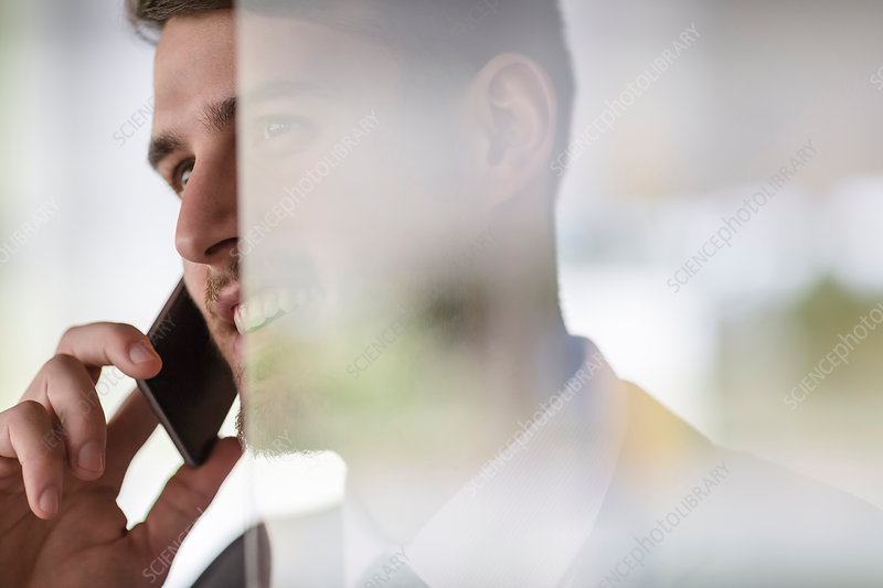 Close up businessman talking on cell phone