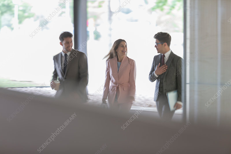 Business people walking and talking in office