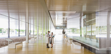 Scientists in lab coats talking lobby corridor