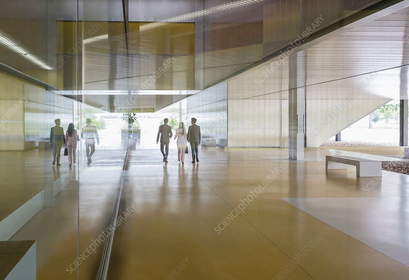 Business people walking lobby corridor