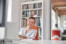 Portrait businesswoman working at laptop in office