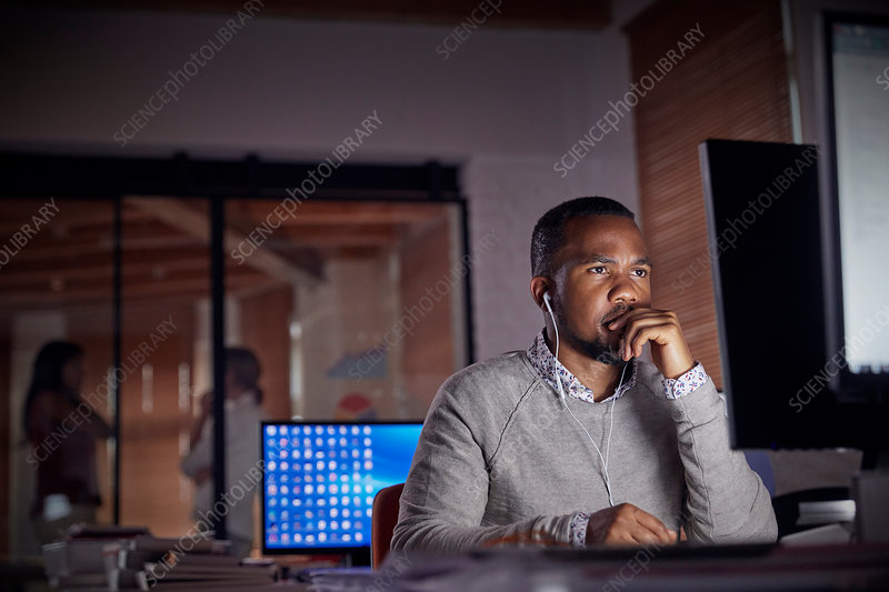 Serious, focused businessman working late