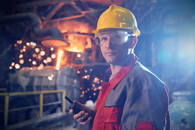 Portrait steelworker with walkie-talkie