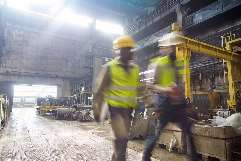 Steelworkers walking in steel mill