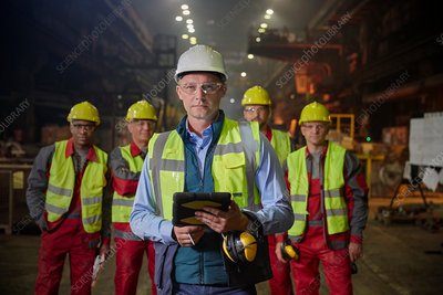 Portrait confident supervisor and steelworkers