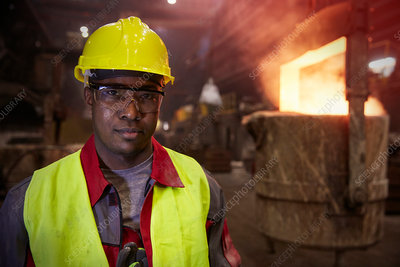 Portrait serious steelworker in steel mill