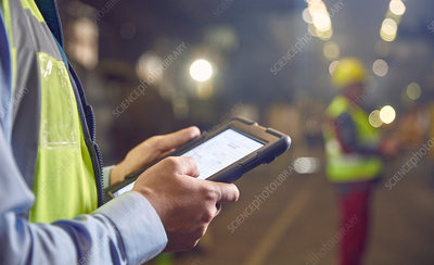 Close up steelworker supervisor using tablet