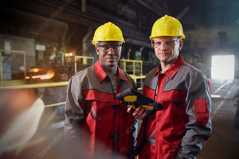 Portrait confident steelworkers with tablet