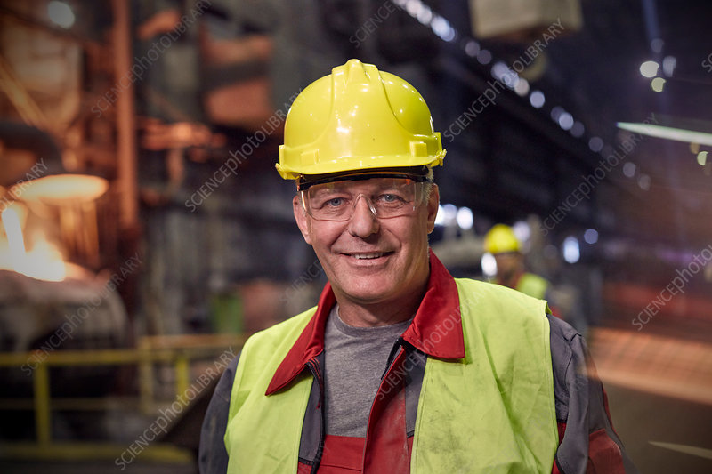 Portrait steelworker in steel mill