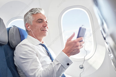 Businessman listening to music and mp3 player