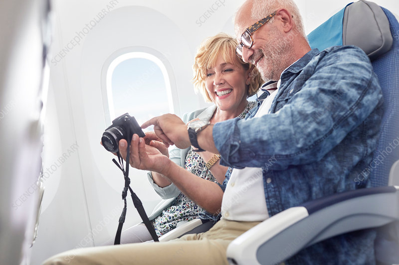 Mature couple looking at photos on digital camera