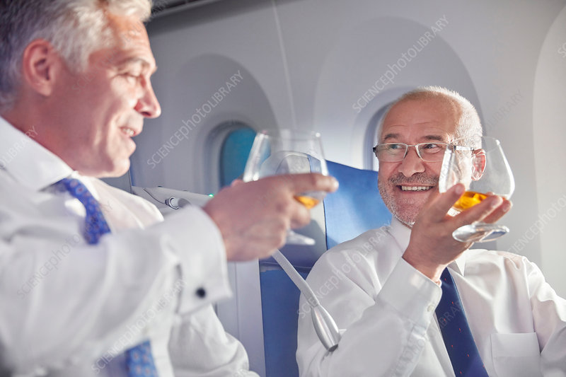 Businessman toasting whiskey glasses