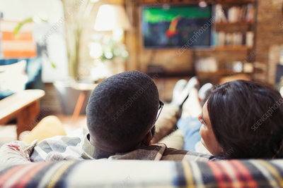 Young couple relaxing, watching TV