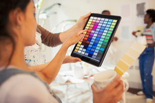 Young woman viewing digital paint swatches