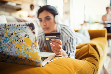 Young woman and credit card online shopping