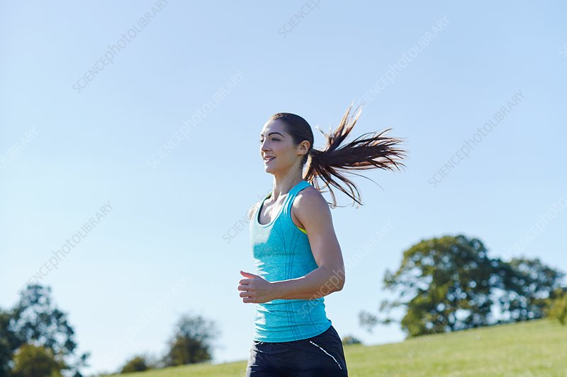 Young woman jogging on a path