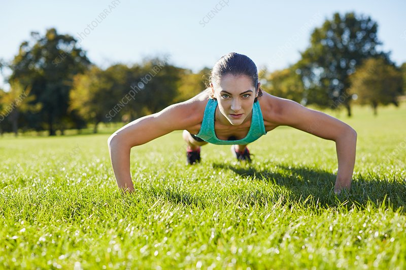 Young woman doing push-up