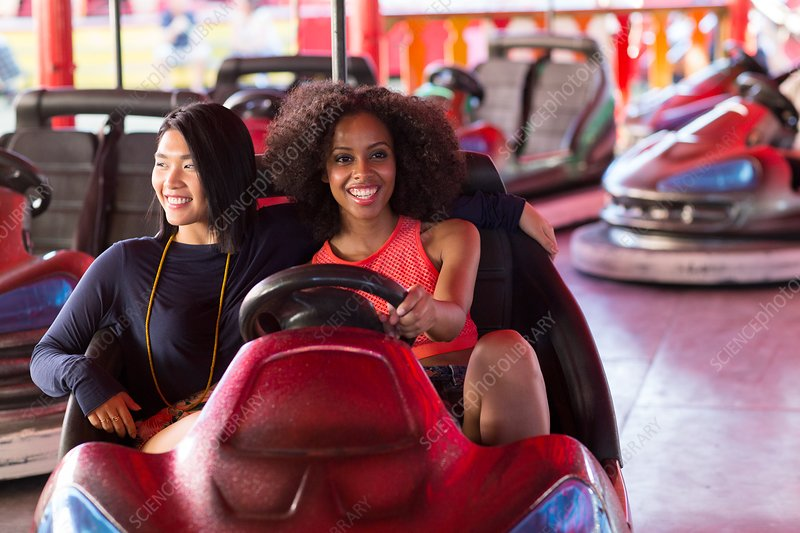 Women on bumper car at fun fair