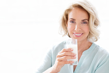 Mature woman smiling with drink