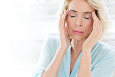 Mature woman with headache