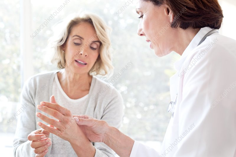 Mature woman showing gp painful hand