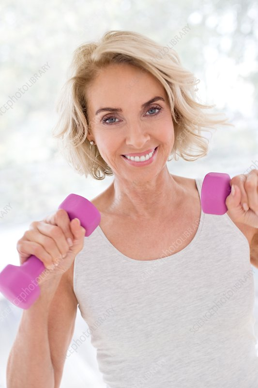 Mature woman using hand weights