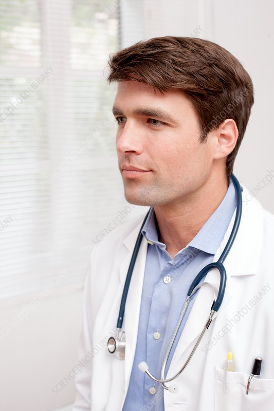 Doctor in uniform looking away