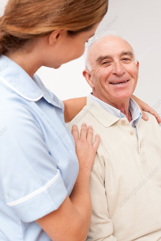 Nurse with senior male patient