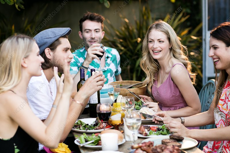 Group of friends eating lunch outdoors