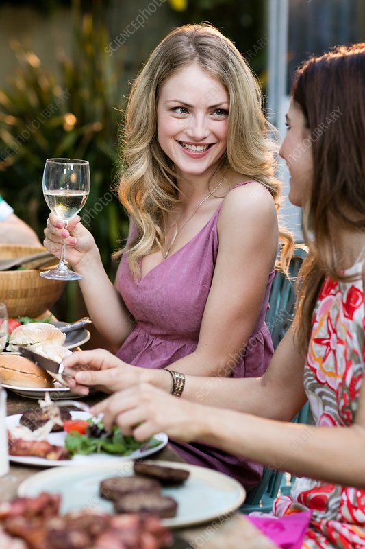 Woman having lunch outdoors with friends