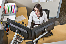 Woman working in office cubicle
