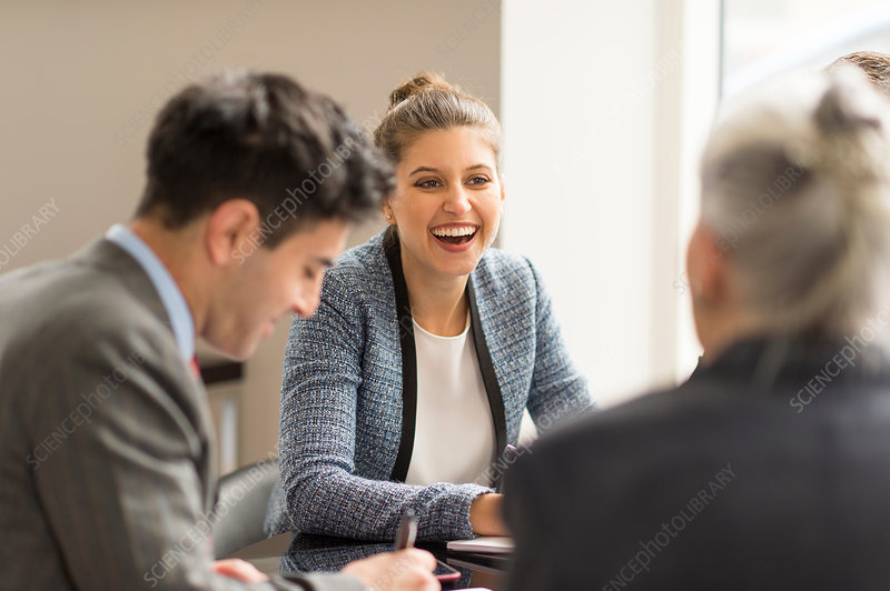 Businessman meeting female colleagues in boardroom