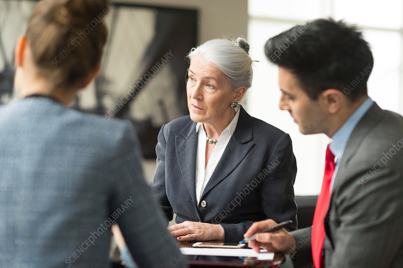 Businessman discussing with female colleagues