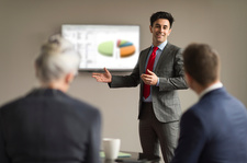 Businessman making office presentation to colleagues