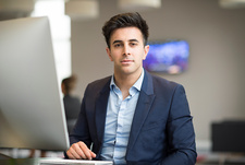 Portrait of confident businessman at office desk