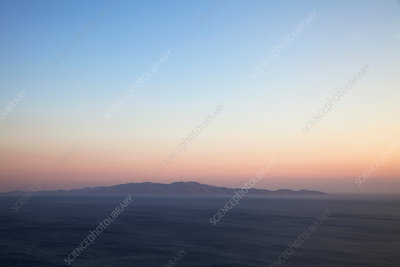 Seascape and distant view at sunset, Greece