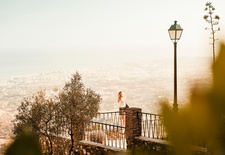 Woman on viewing platform overlooking town, Spain