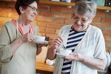 Senior adult women drinking coffee together