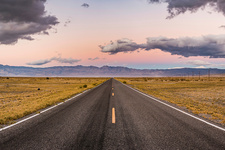 Straight road at sunset in Death Valley, USA