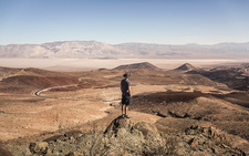 Man on rock looking out over Death Valley, USA
