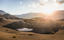 Sunlit landscape at Ubehebe Crater in Death Valley, USA