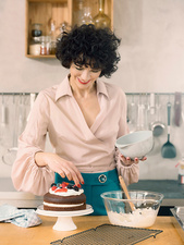 Woman decorating chocolate cake
