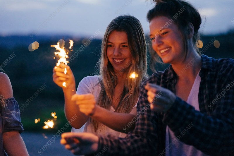Friends playing with sparklers