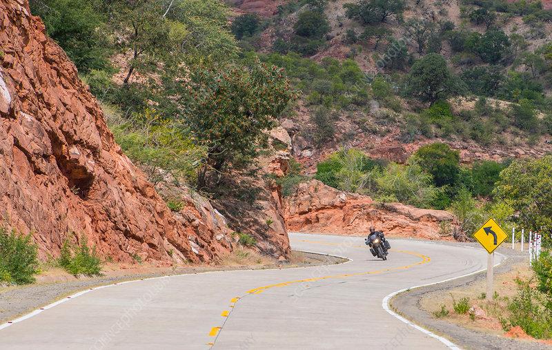 Man driving on touring motorbike, Potosi, Bolivia
