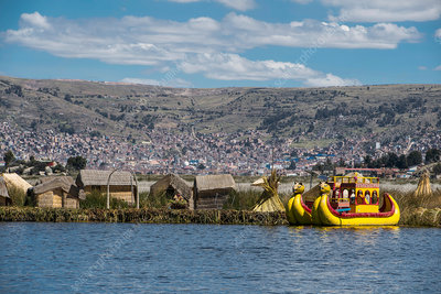 Boat at the floating islands on the Titicaca lake, Peru