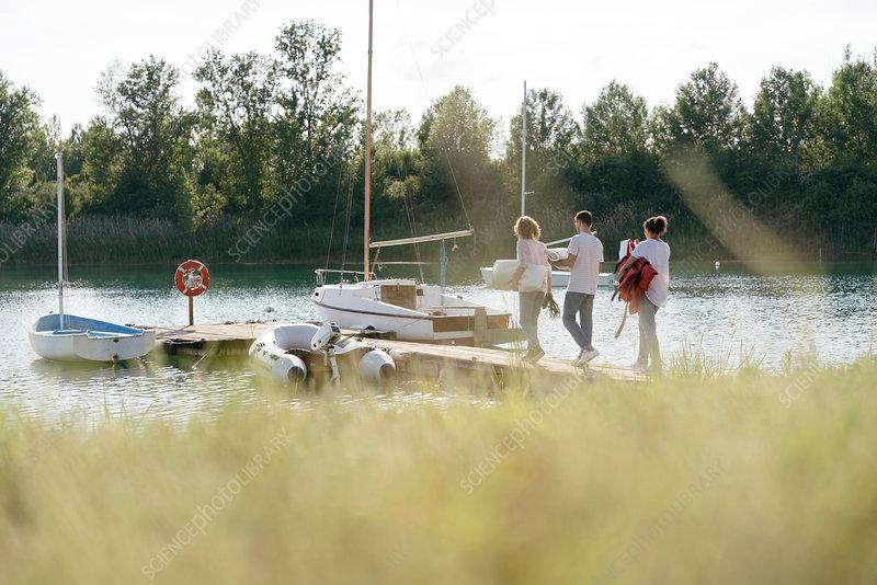 Friends walking towards sailing boat